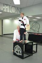 Taekwondo belt ceremony with dad
